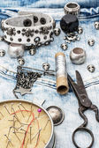 Sewing accessories and skull jewelry — Stock Photo