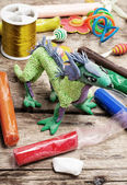 Creative modeling child of colored clay — Stock Photo