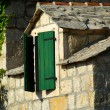 Old stone house and window - Stock Photo