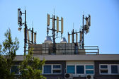 Big antenna on the roof of building — Stock Photo