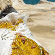 Pile of fishing nets stored in sack — Stock Photo #12744674
