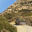 Pick up truck in the dry hills of crete — 图库照片