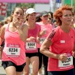 Runners dressed in pink — Stock Photo