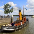 Steam boat, Scheelenkuhlen leaving harbor - Stock Photo