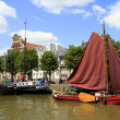 Historic boats in Wolwevershaven harbor - Stock Photo
