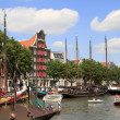 Many historic boats in Wolwevershaven harbor — Stock Photo