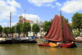 Historic boats in Wolwevershaven harbor — Stock Photo