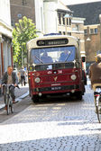 Old timer bus driving through Dordrecht — Stock Photo