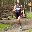 Foto de Stock  : Jolien Janssen running wooded part of course