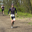 Stock Photo: Runners in wooded part of course