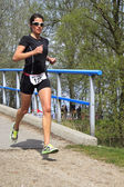A contender, Jolanda Nell running the course — Stock Photo
