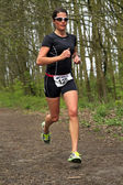 Jolanda Nell running the wooded part of the course — Stok fotoğraf