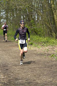 Runners in the wooded part of the course — Stok fotoğraf