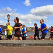Runners in the sunshine along the river - Stock Photo
