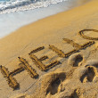 Hello greeting written in a golden sandy beach — Stock Photo