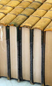 Antique books stacked together — Stock Photo