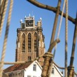 Royalty-Free Stock Photo: Dordrecht cathedral and rigging of an old galleon ship