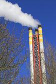 Incinerator chimney emitting smoke — Stock Photo
