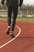 Athlete warming up on a race track — Stock Photo