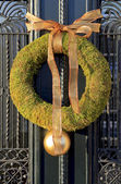 Christmas wreath hanging on a door — Stock Photo