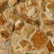 Stock Photo: Orange tinted stone wall background