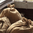 Jute sacks waiting to be loaded — Stock Photo