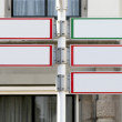 Stock Photo: Red and green directional sign post