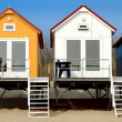 Stock Photo: Yellow blue and white beach houses