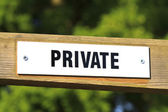 Private sign on a wooden gate — Stock Photo