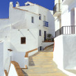Pathway leading through the village Frigiliana - Stock Photo