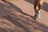 Runner crossing the finish line — Stock Photo