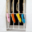 Stock Photo: Four brightly colored shoes