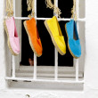 Stockfoto: Four shoes hanging