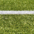White stripe on a green artificial field — Stock Photo