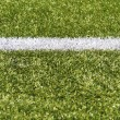 Stock Photo: White stripe on green artificial field