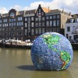 Huge plastic globe named World Litter — Stock Photo