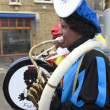 Marching band dressed as Zwarte Piet — Stock Photo