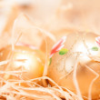 Christmas background with boll and strow in gold — Stock Photo #35778155