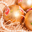 Stock Photo: New year background with boll and strow in gold