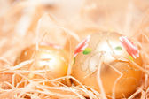 Christmas background with boll and strow in gold — Stock Photo