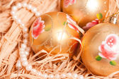 New year background with boll and strow in gold — Stock Photo