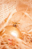 New year background with boll and straw in gold — Stock Photo