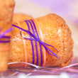 Muffin with purple ribbon — Stock Photo #39389879