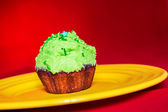Sweet dessert with green cream — Stock Photo