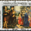 NEW ZEALAND - CIRCA 1984: A stamp printed in New Zealand, dedicated to the Christmas shows Adoration of the Shepherds, by Lorenzo Di Credi, circa 1984 — Stock Photo #11972222