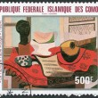 """A stamp printed in the Comoros, shows a painting by Pablo Picasso """"The Red Tablecloth"""", circa 1981 Ключевые слова:brand, collection, collector, communication, — Stock Photo #12086026"""