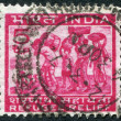 Royalty-Free Stock Photo: A stamp printed in India, shows a family of refugees (a series of stamps to help the refugees from East Pakistan), circa 1971