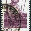 Royalty-Free Stock Photo: A stamp printed in India, shows a man for weaving, circa 1983