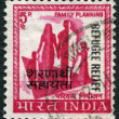 Stock Photo: Stamp printed in India, shows symbol of family planning campaign (overprint in 1971, to help refugees from East Pakistan), circ1967
