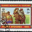 A stamp printed in the Afghanistan devoted to World Tourism Day. Depicted Camel driver, tent, camel in caparison, circa 1984 — Stock Photo #12086001